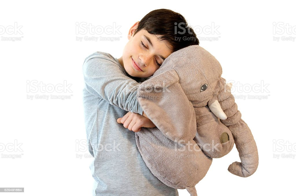 Kid with stuffed toy. royalty-free stock photo