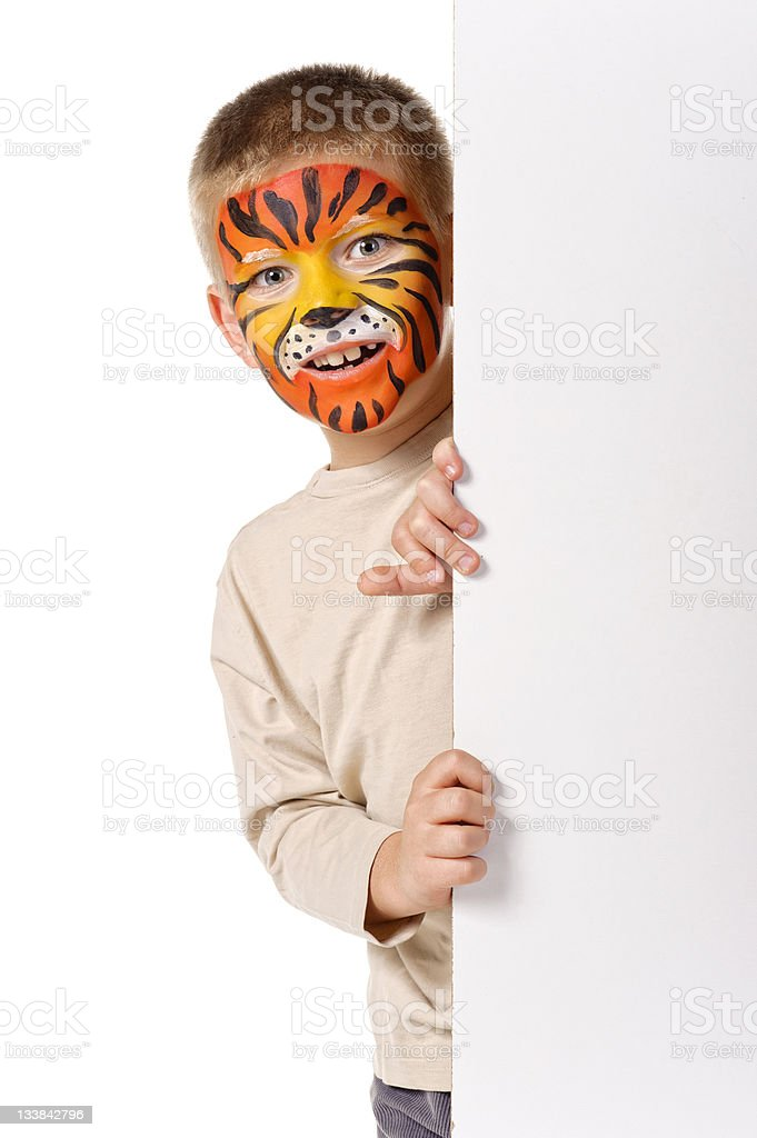 Kid with tiger painted face. On white background royalty-free stock photo