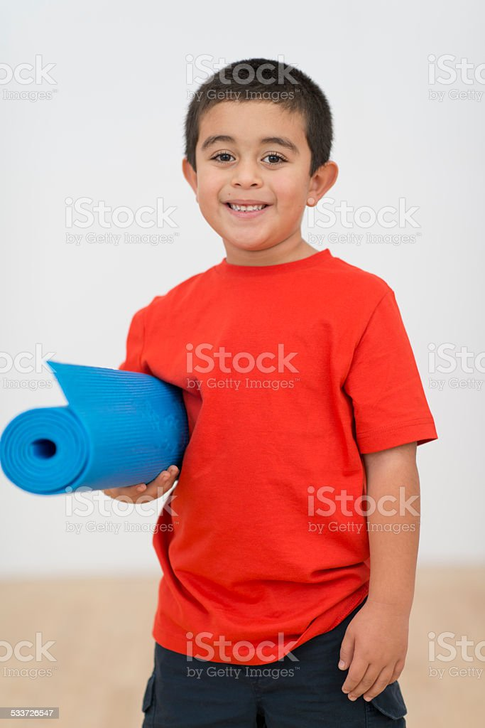 Kid with yoga mat stock photo