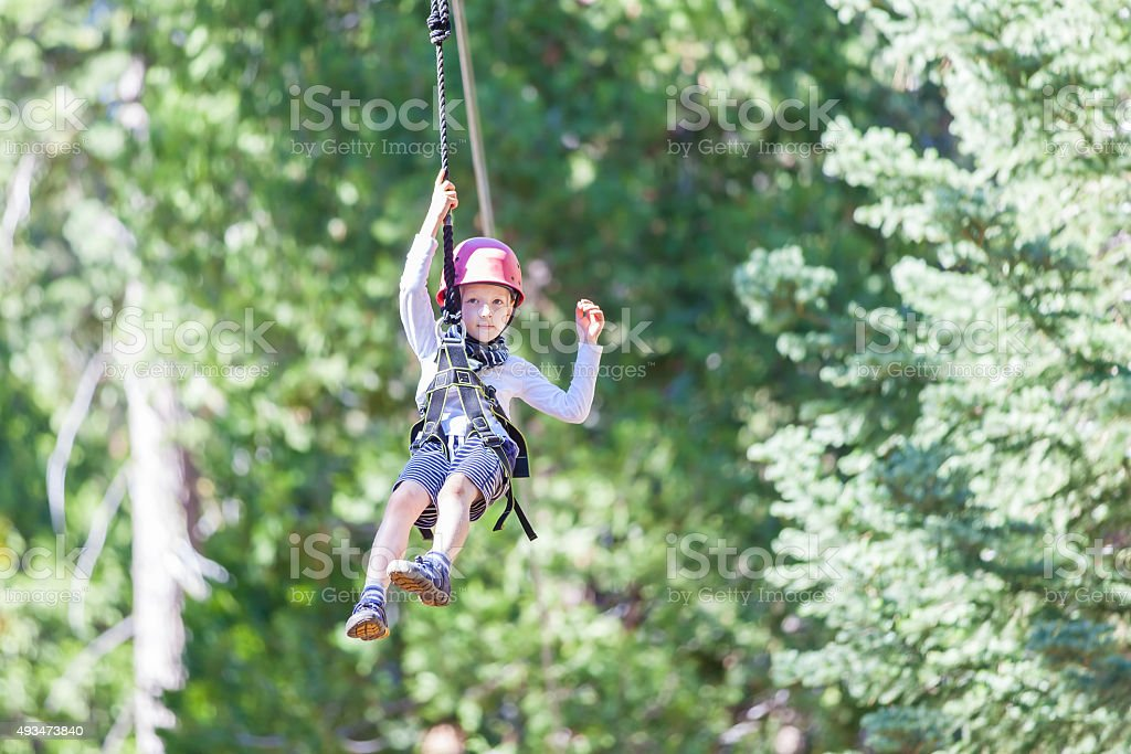 kid ziplining stock photo