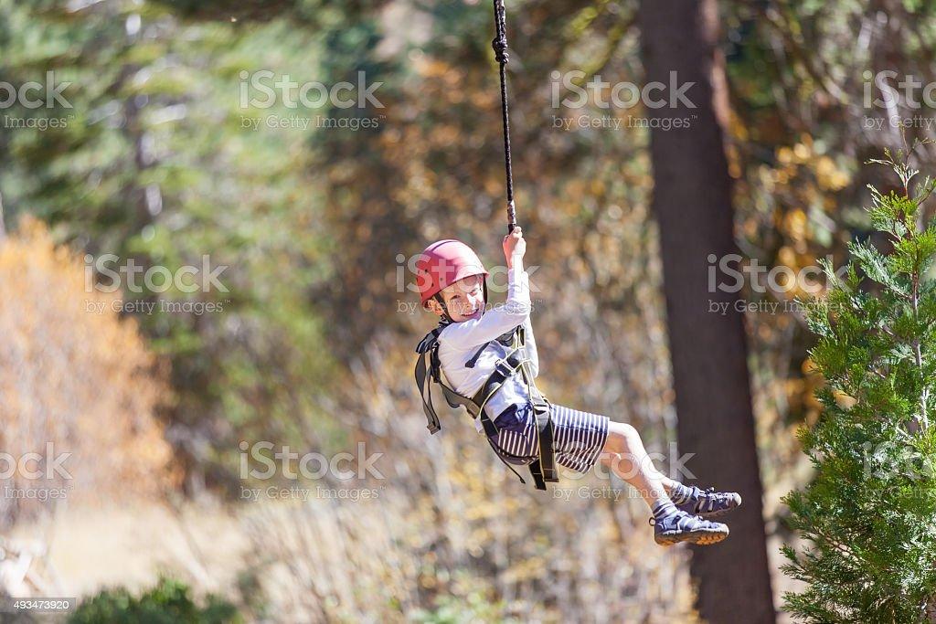 kid ziplining stock photo