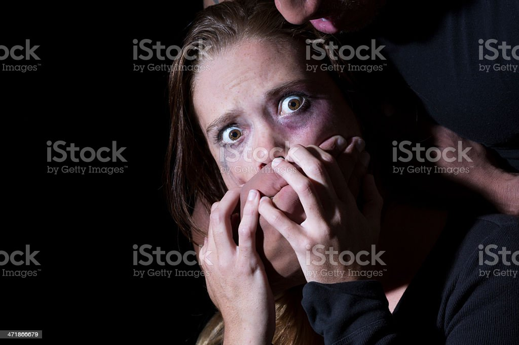 Kidnapped - scared woman's face with hand covering her mouth royalty-free stock photo