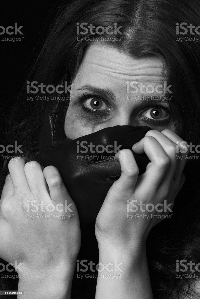 Kidnapped - woman's face with a hand covering her mouth stock photo