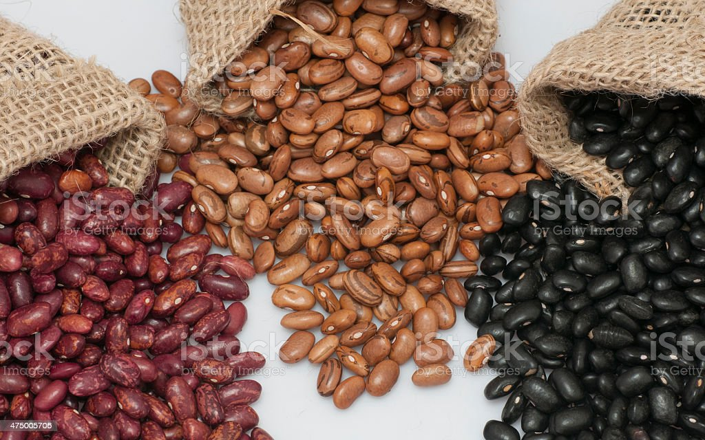 Kidney beans, pinto beans and black beans. stock photo