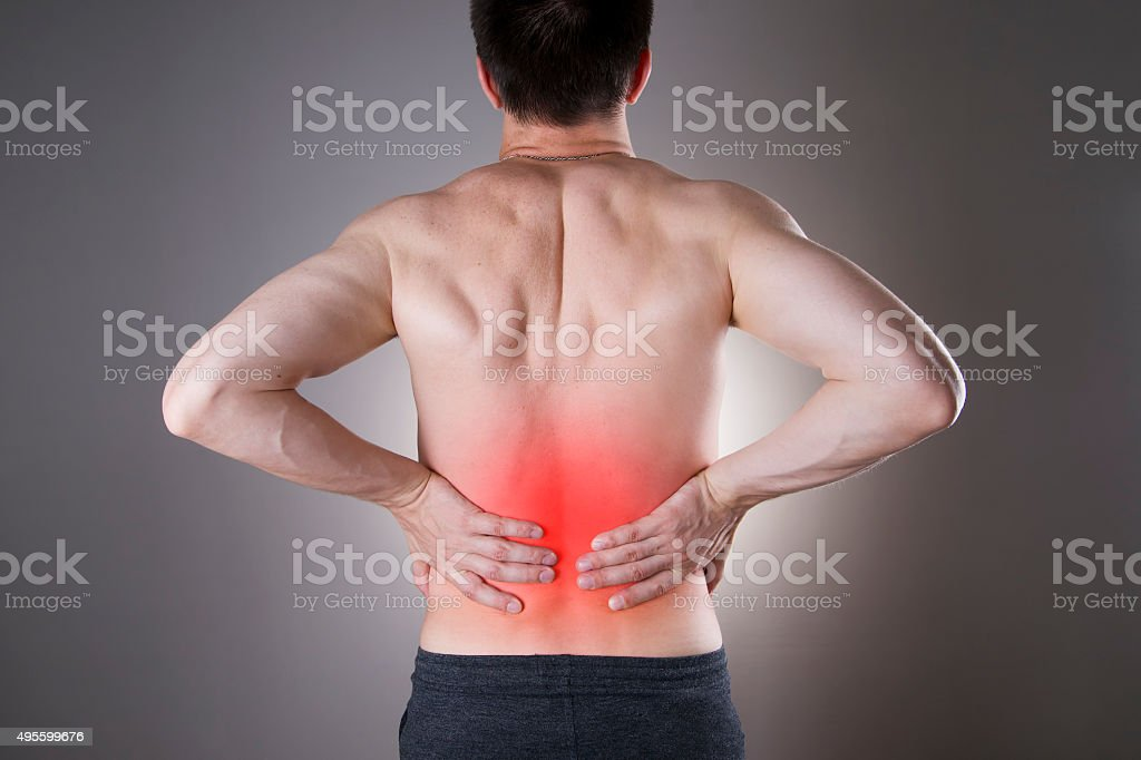Kidney pain. Man with backache. Pain in the man's body stock photo