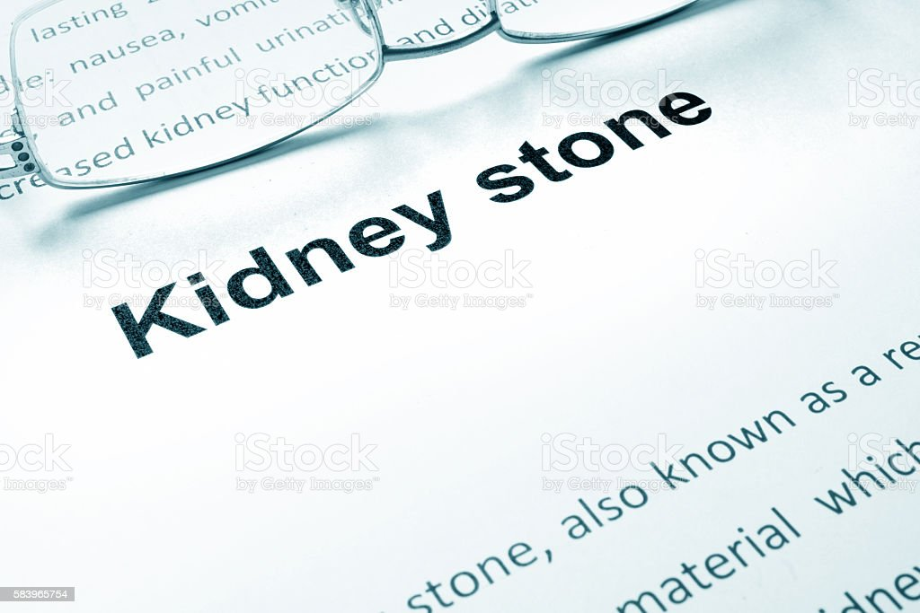 Kidney stone sign on a paper and glasses. stock photo