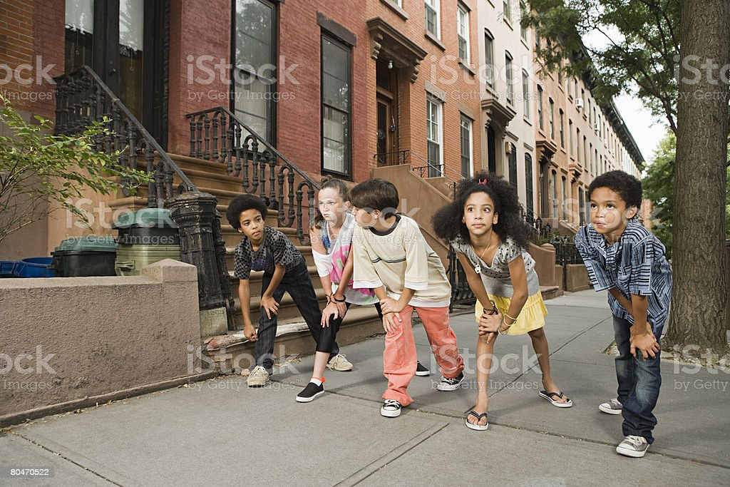 Kids about to race on sidewalk royalty-free stock photo