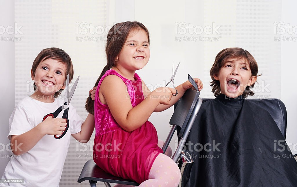kids acting like hairdressers stock photo