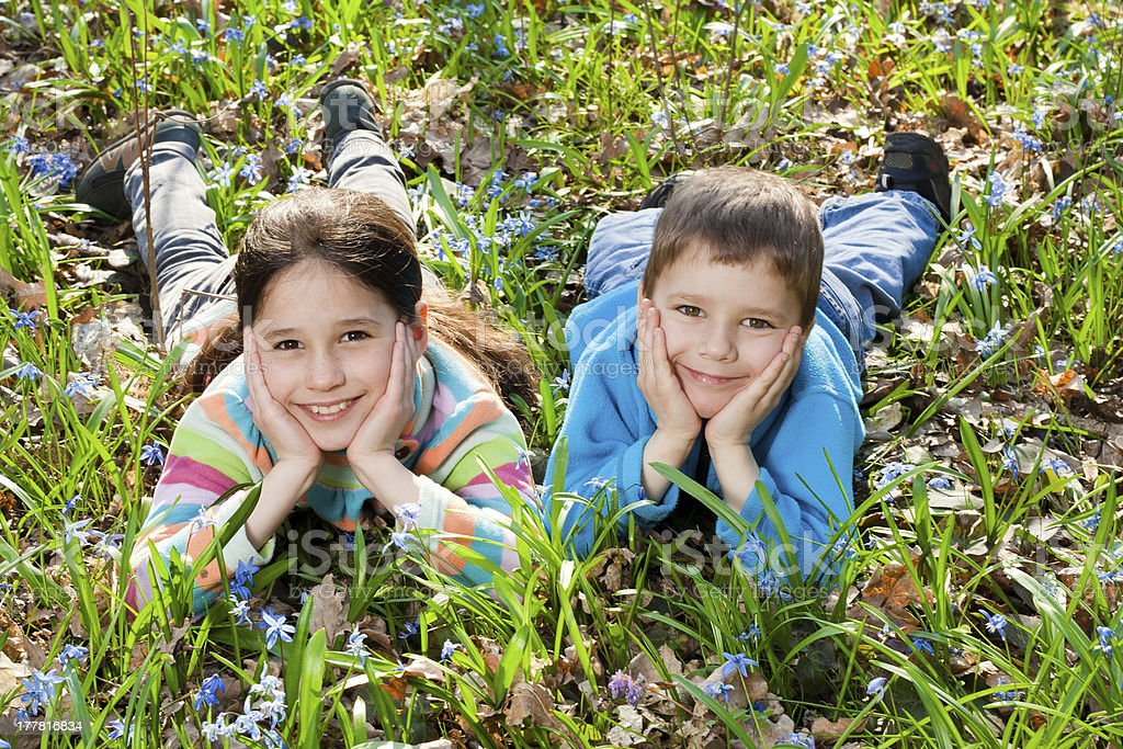 Kids among the bluebells royalty-free stock photo
