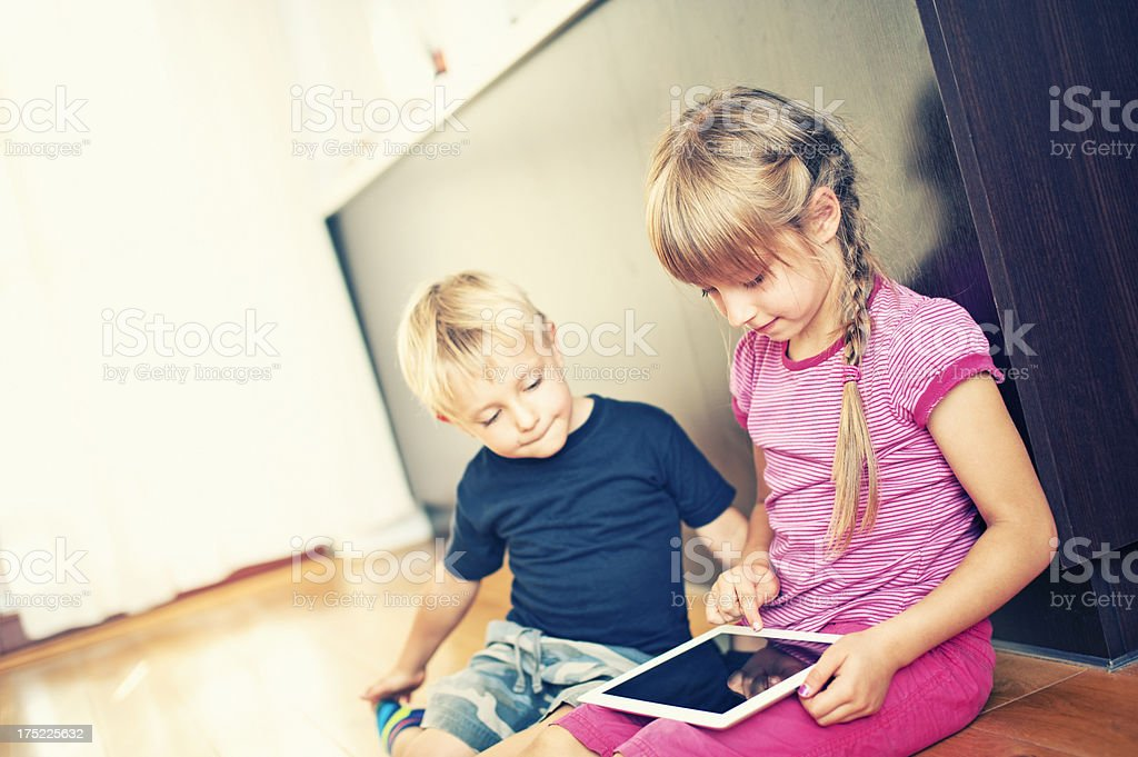 Kids and a tablet royalty-free stock photo