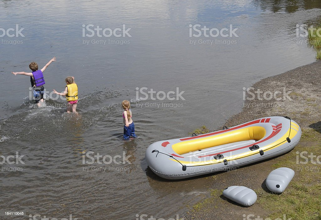 Kids and Raft stock photo