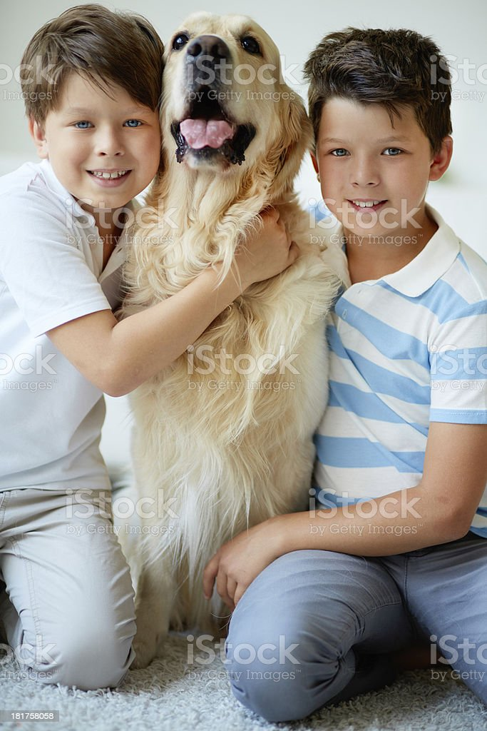 Kids and their pet royalty-free stock photo