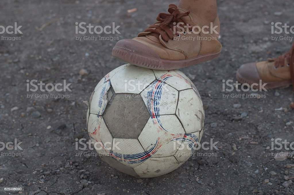 kids are playing soccer football for exercise in the evening. stock photo
