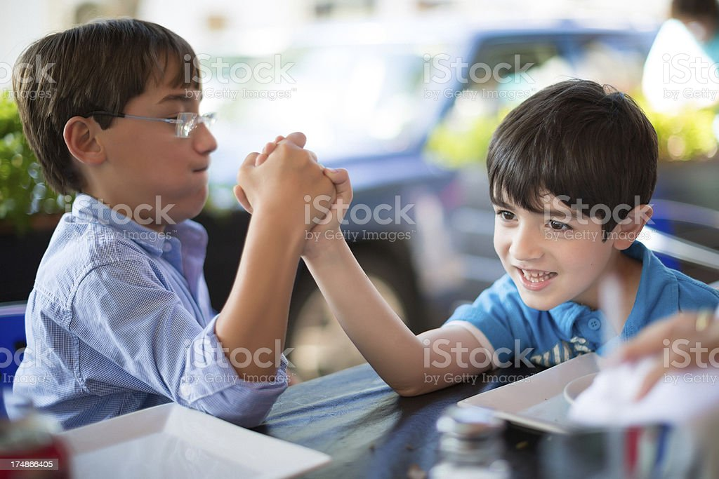 kids arm wrestling royalty-free stock photo