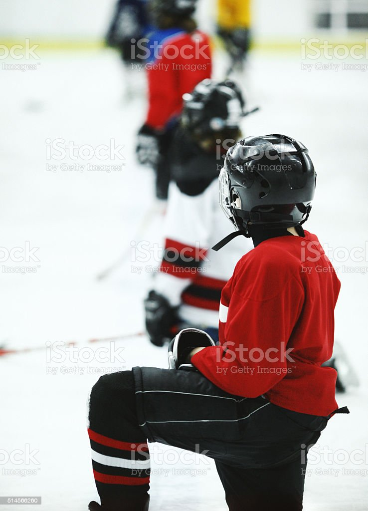 Kids at ice hockey practice. stock photo