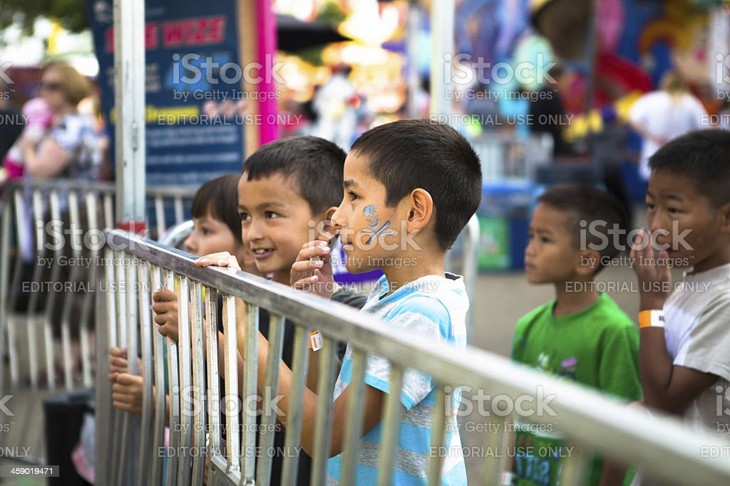 Kids at the amusement park royalty-free stock photo