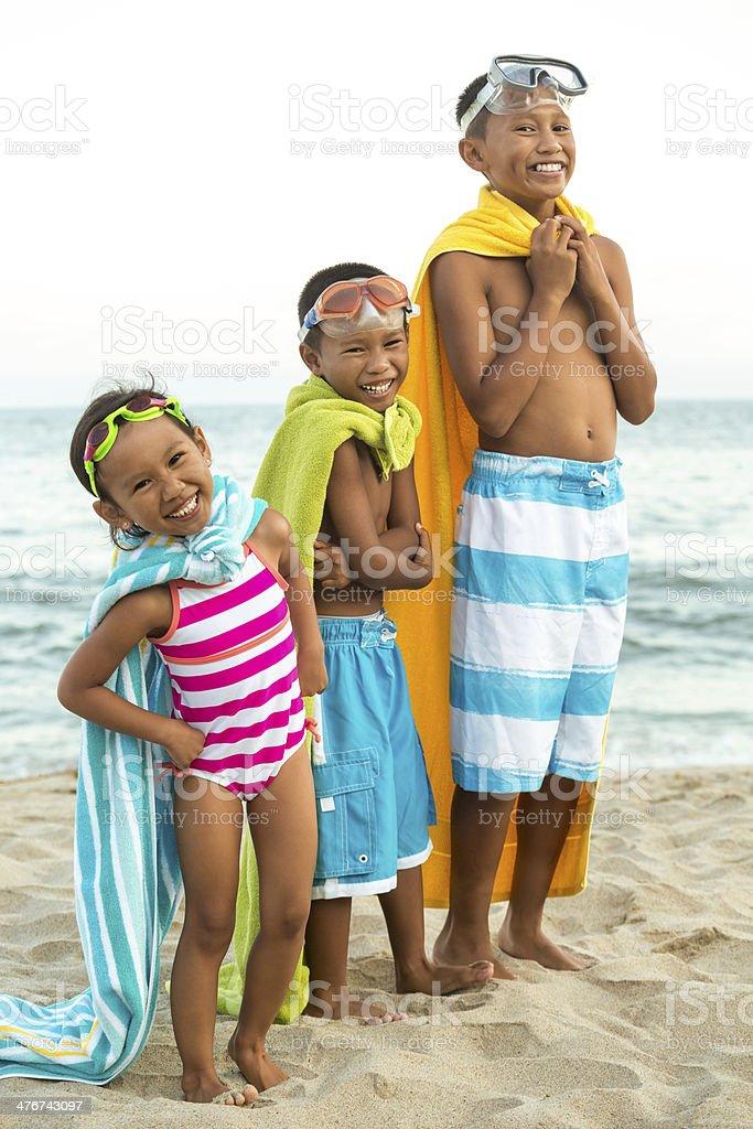 Kids at the beach stock photo