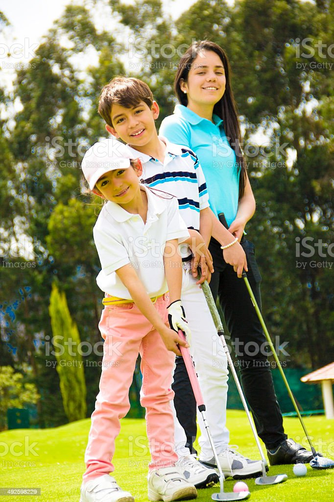 Kids at the golf course stock photo