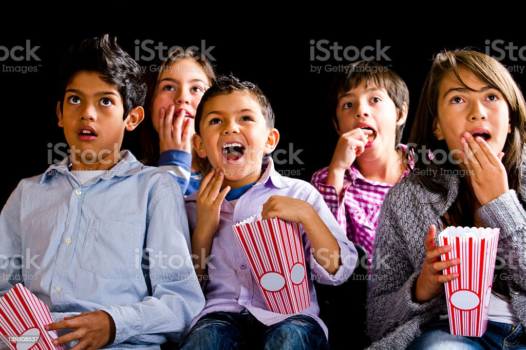 Kids at the movies stock photo