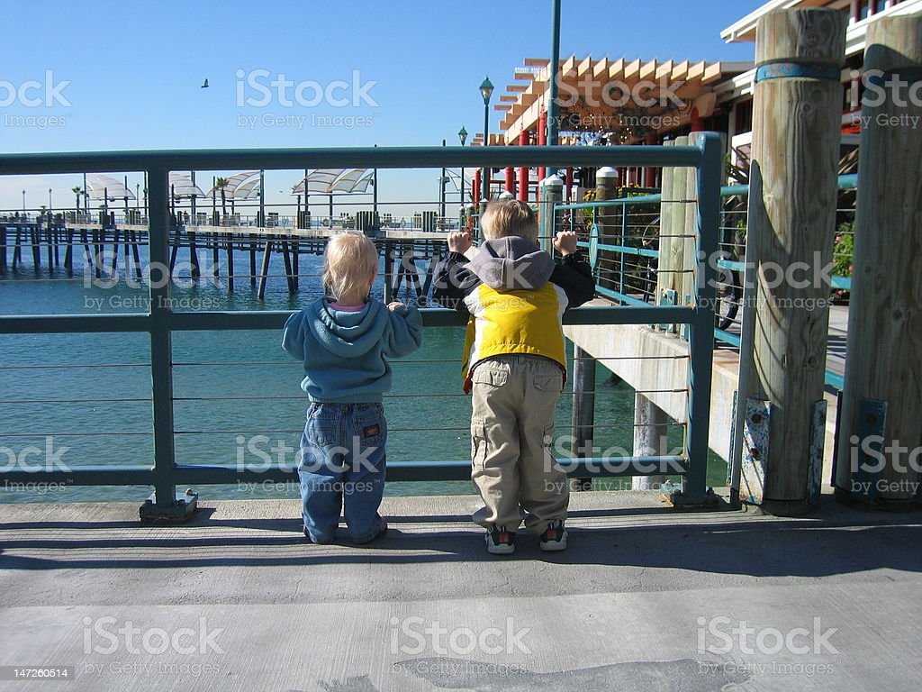 Kids at the pier stock photo
