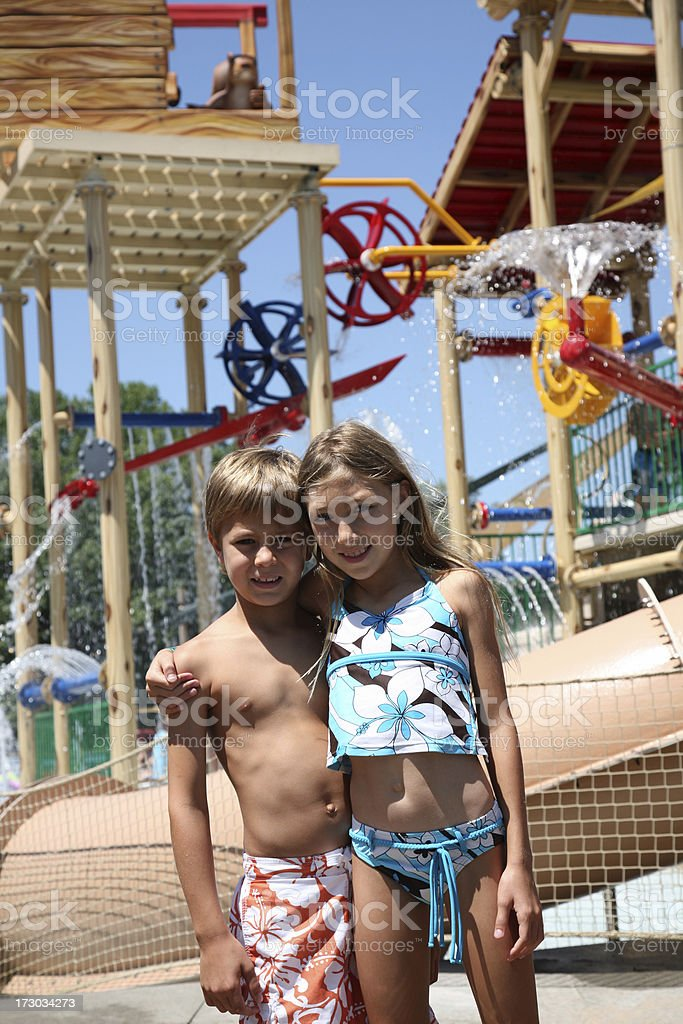Kids at Water Park playground on beautiful sunny day royalty-free stock photo