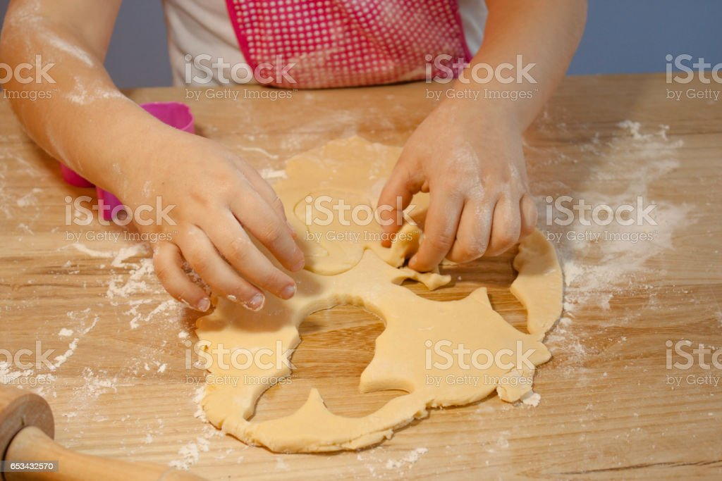 kids bakery class, making easter bunny cookies stock photo