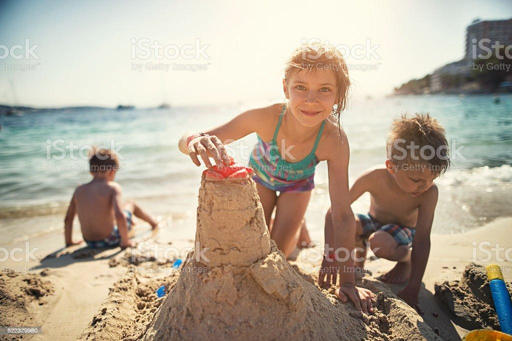 Kids building a sandcastle stock photo