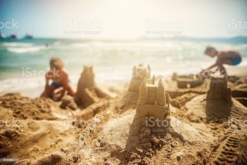 Kids building sandcastles stock photo