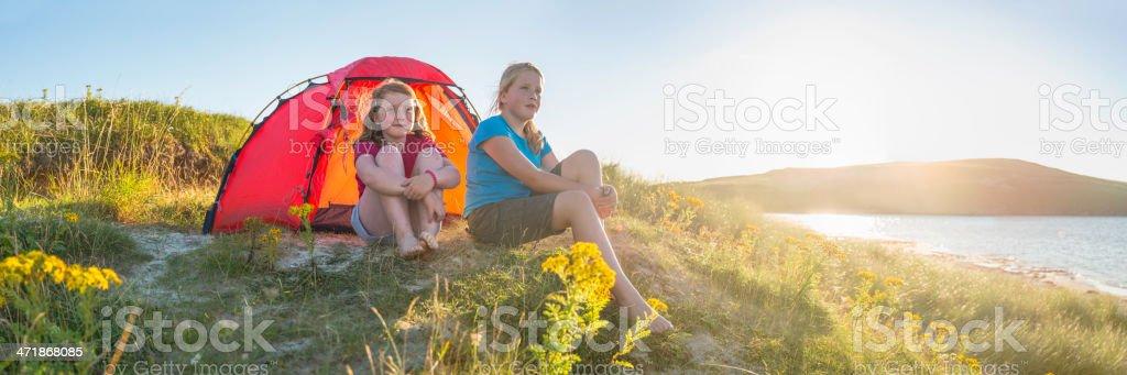 Kids camping idyllic golden beach dunes overlooking tranquil summer ocean stock photo