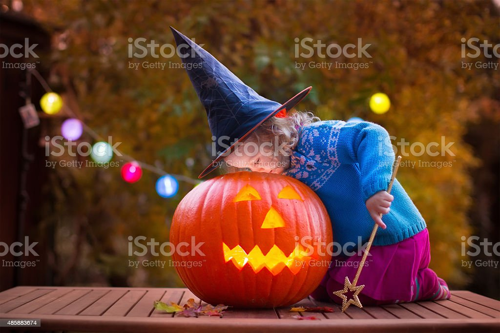 Kids carving pumpkin at Halloween stock photo