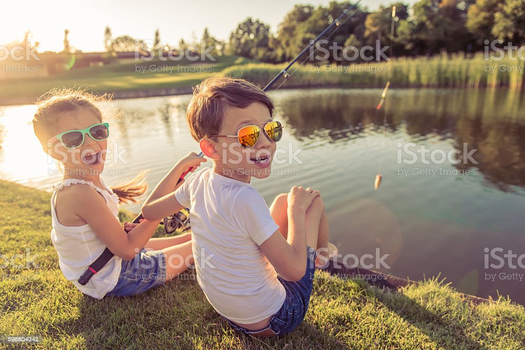 Kids catching fish stock photo