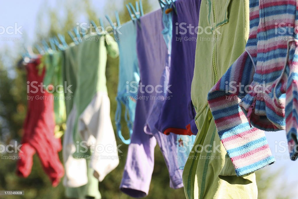 Kids Clothes Drying on a Clothing Line stock photo