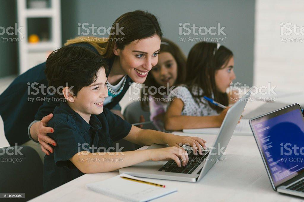 Kids Coding In School stock photo
