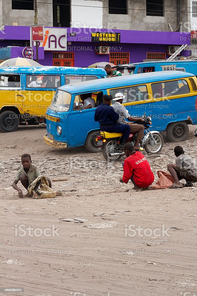 Kids Collecting Rocks on The Road stock photo