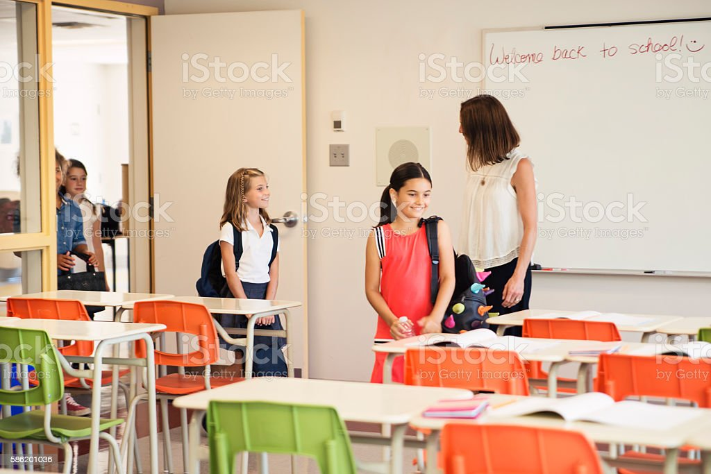 Kids coming in class for the first day of school. stock photo