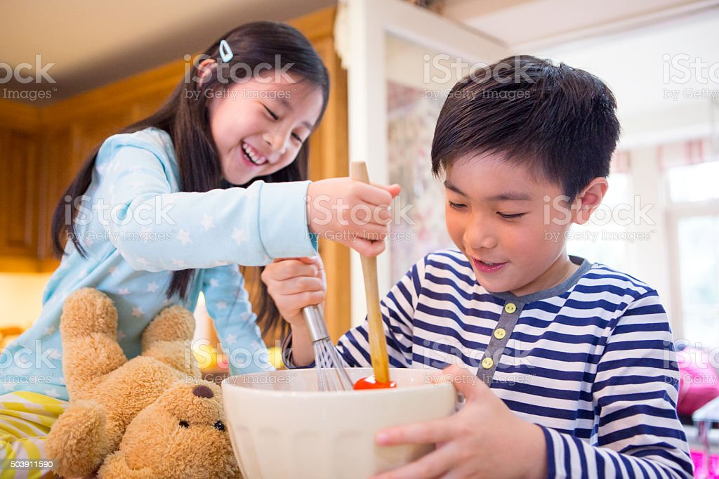 Kids Cooking stock photo