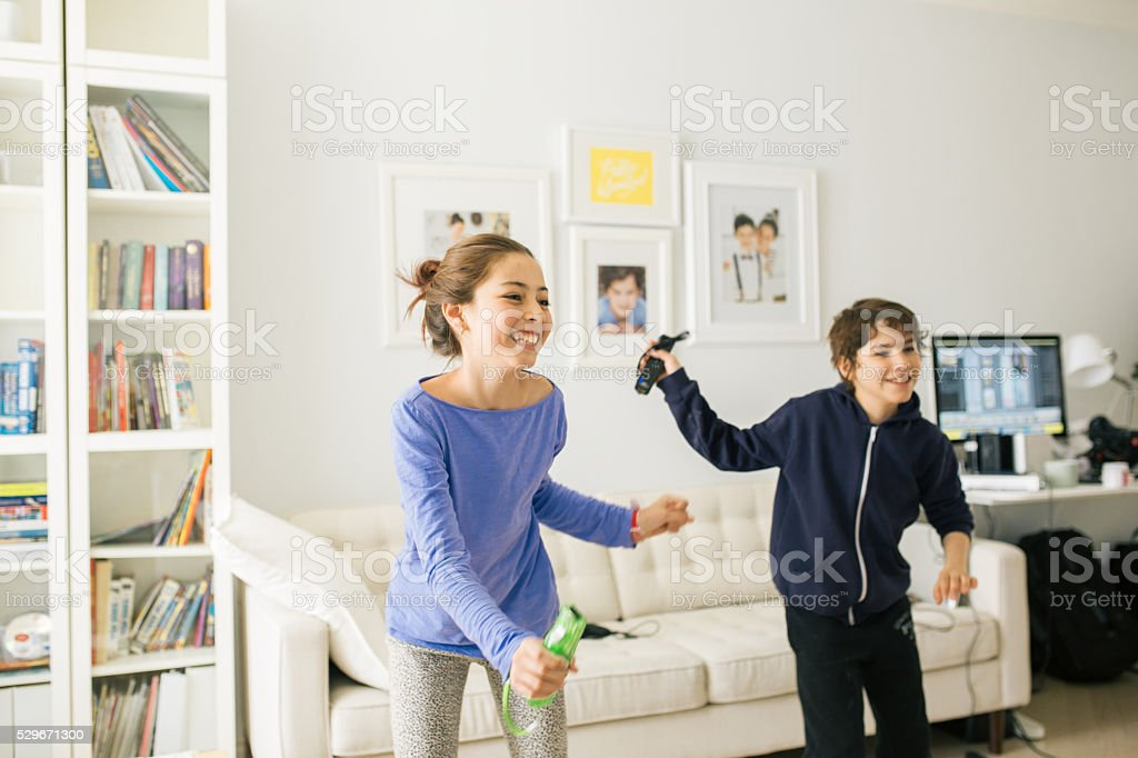 Kids dancing with gadgets stock photo