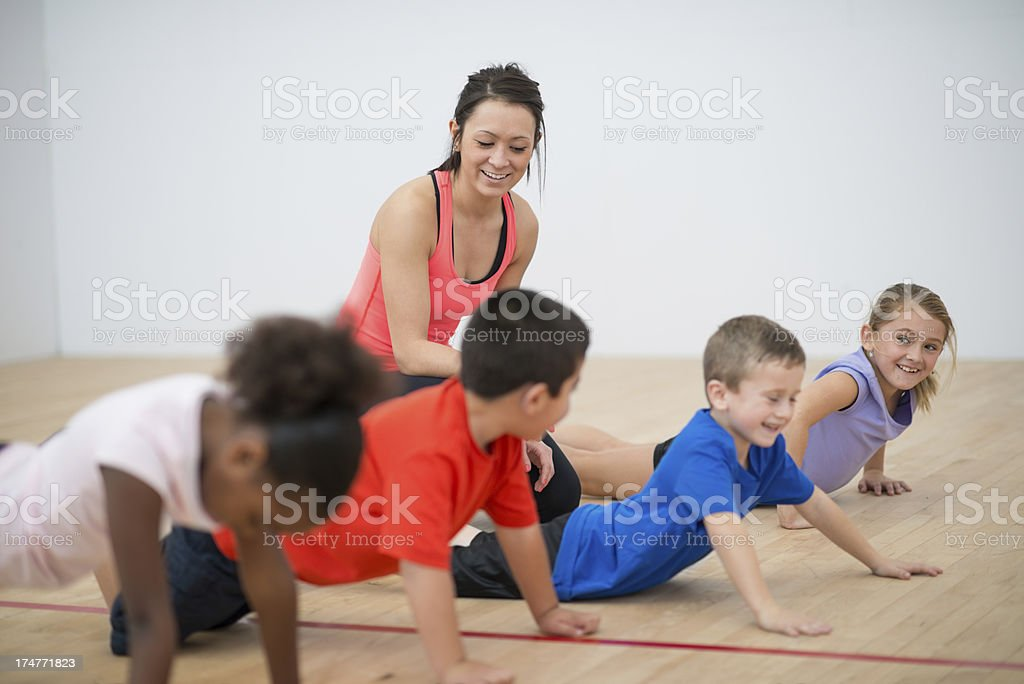 Kids doing push ups. stock photo