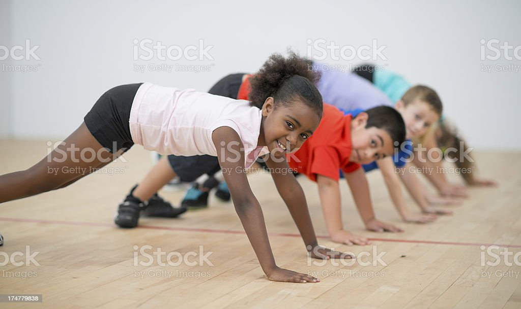 Kids doing push ups stock photo