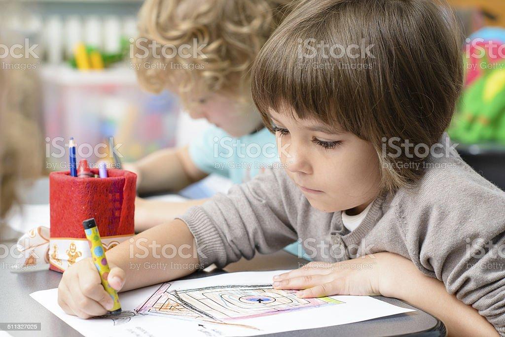 Kids Drawing at Kindergarten stock photo