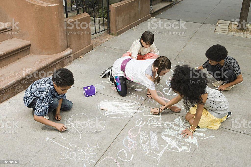 Kids drawing on sidewalk royalty-free stock photo