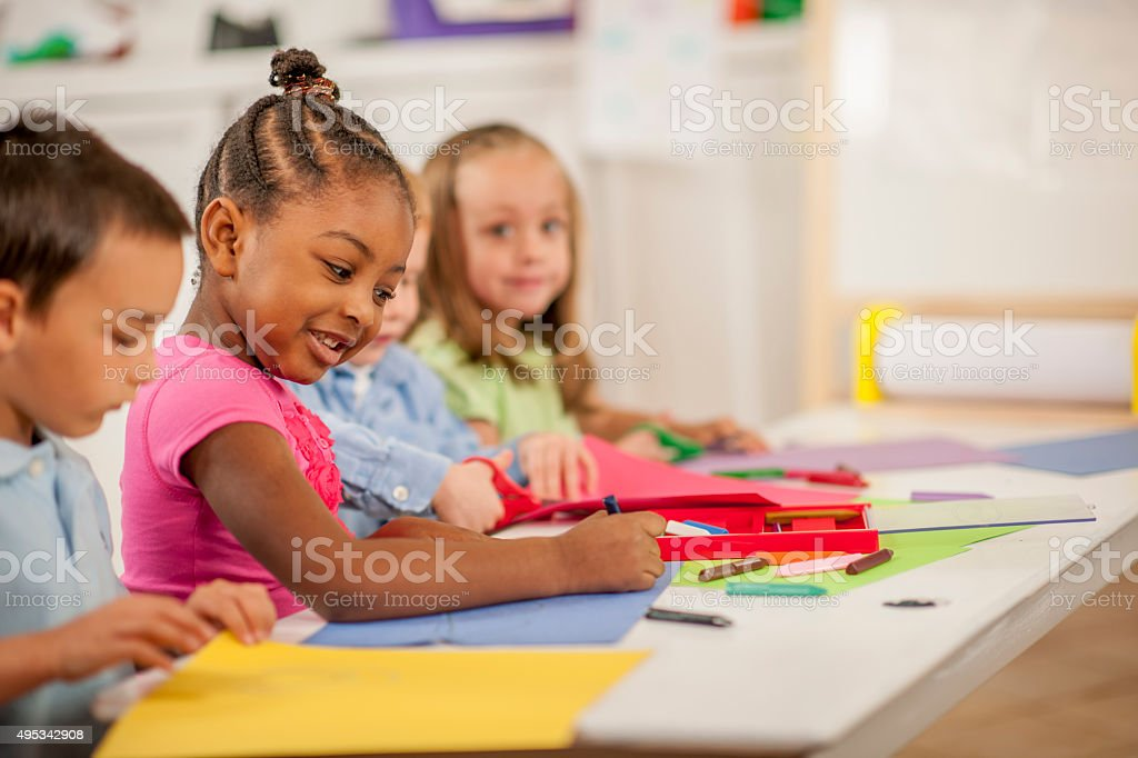 Kids Drawing Together in Class stock photo