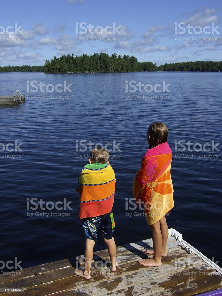 Kids dry off after swim in lake royalty-free stock photo