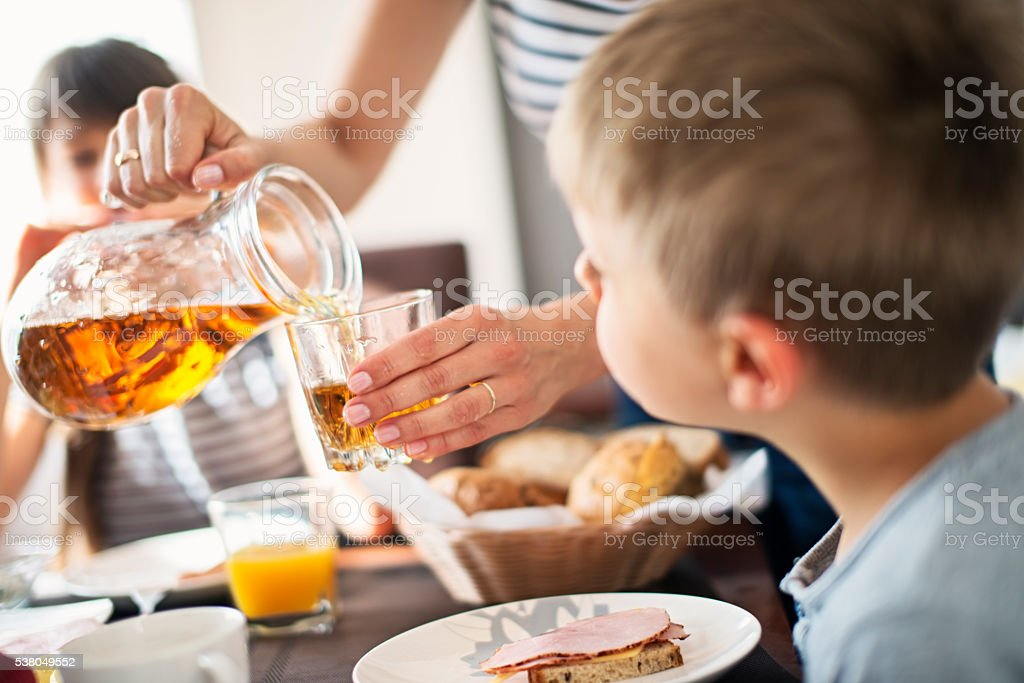 Kids eating breakfast at home stock photo