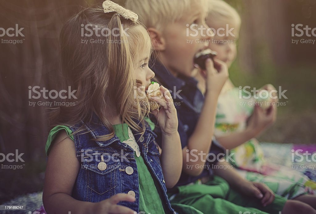 3 Kids Eating Cupcakes royalty-free stock photo
