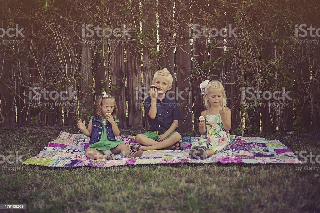 3 Kids Eating Cupcakes stock photo