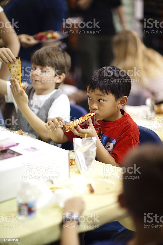 Kids Eating Pizza at a Birthday Party stock photo