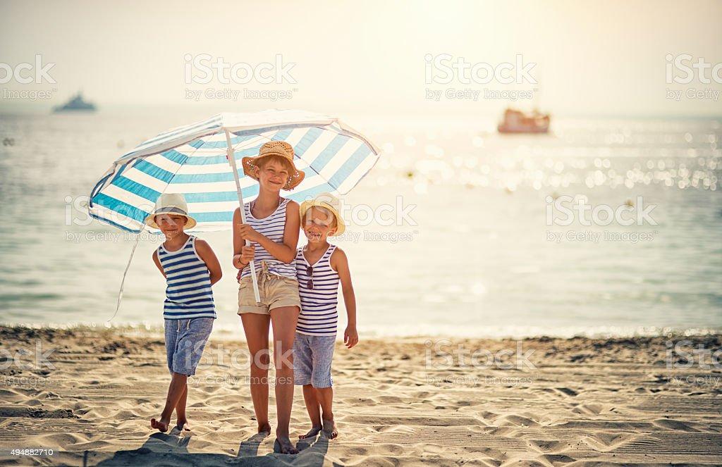 Kids enjoying summer vacation on the beach stock photo