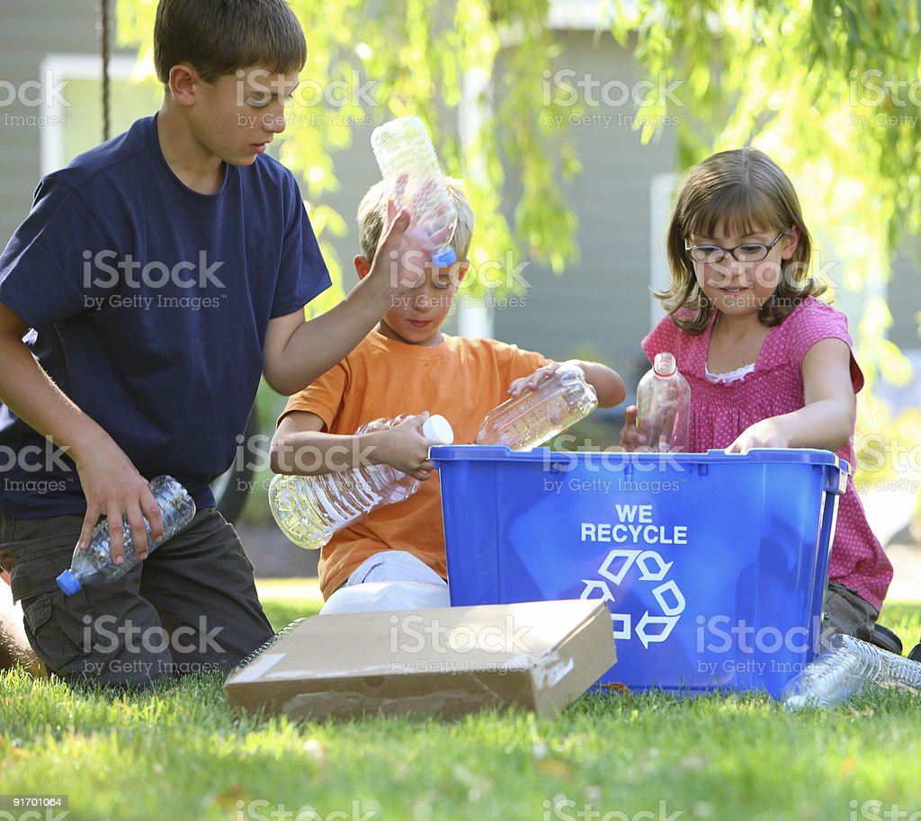 Kids filling recycle bin stock photo