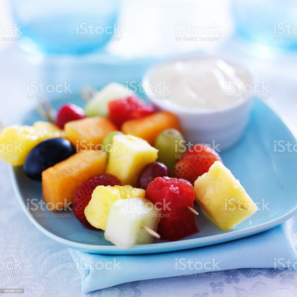 kids food - fruit kabob skewers with yogurt dip stock photo